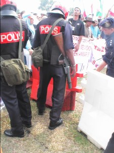Goodness! Are we in a war zone? why are the policemen carrying guns amidst an ordinary crowd?