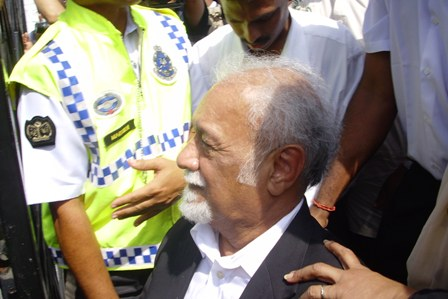 Karpal lodged a police report against those who threw water bottles at his car.